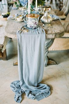 French Countryside Dusty Blue Wedding Inspiration // tablescape, centerpieces, table runner, mercury glass, candlesticks, hydrangea