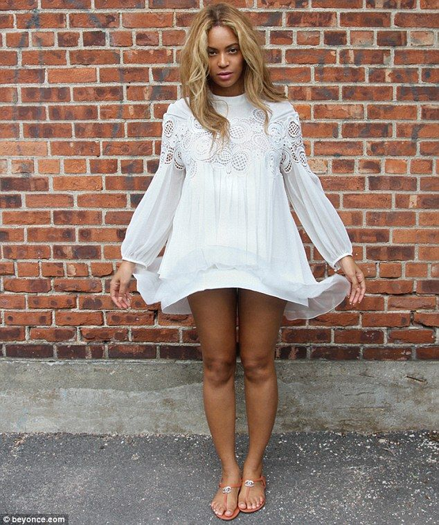 Heavenly: Beyonce shared photos on her website on Tuesday, while going for an angelic look...