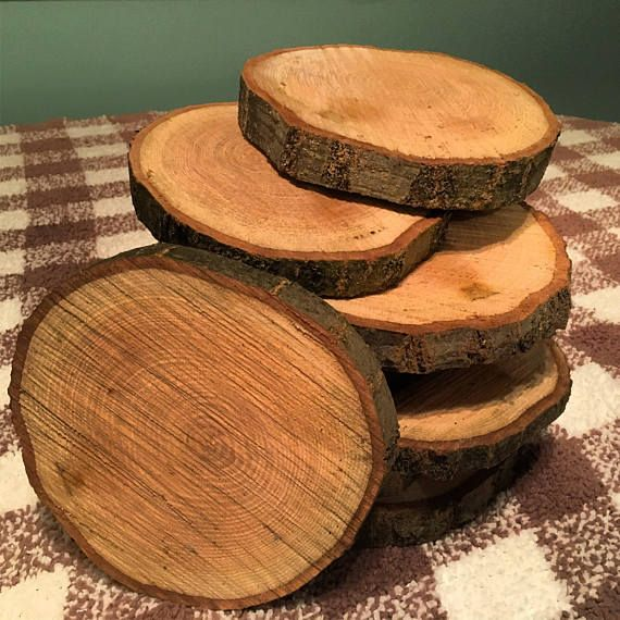 These 10 Rustic Wood Slices Make For Excellent Centerpieces For Any Occasion Wood Slice Centerpiece Wedding Wood Slice Centerpieces Rustic Wedding Centerpieces
