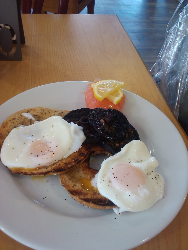 my favourite breakfast from my favourite cafe, boston tea party (south west england)wholegrain bagel,poached eggs,smoked salmon,mushrooms. yumtious