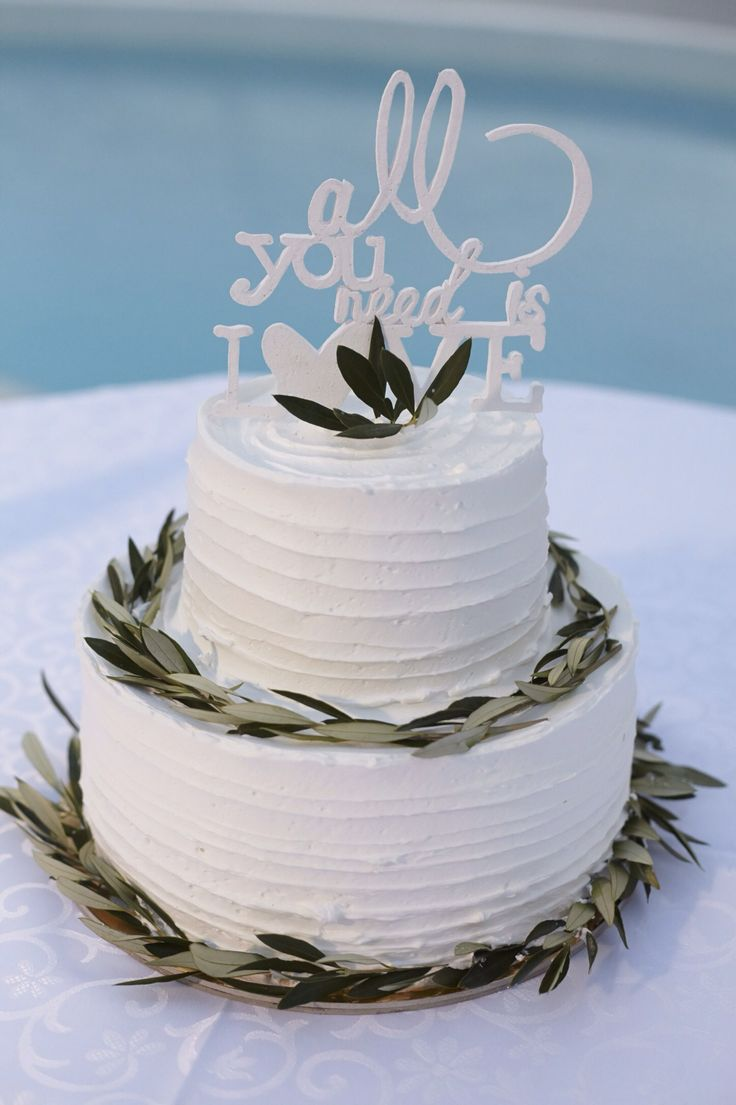 Wedding cake, olive leaves, top cake, decorated the diamond rock