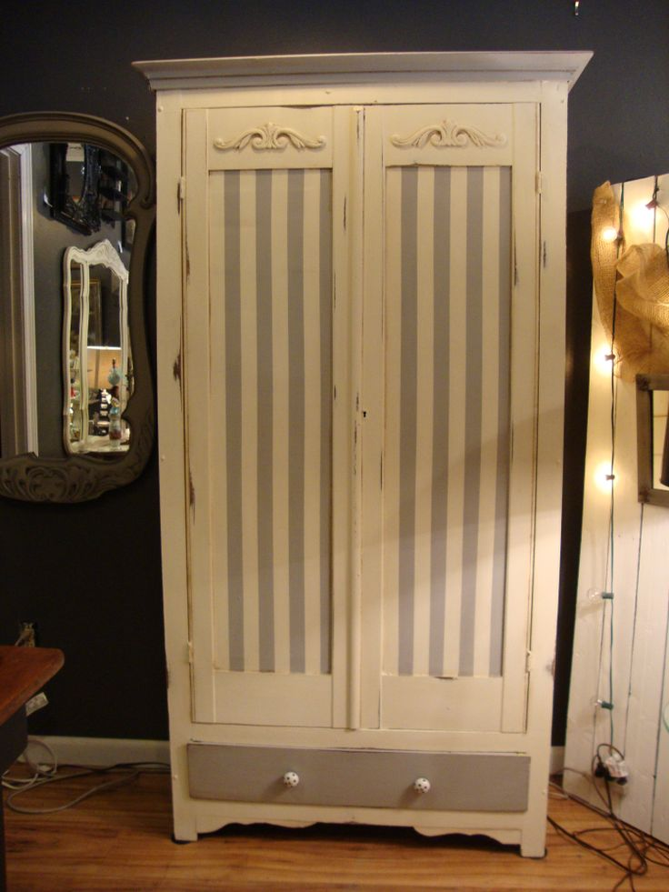 This vintage wardrobe found new life in painted grey and white stripes!