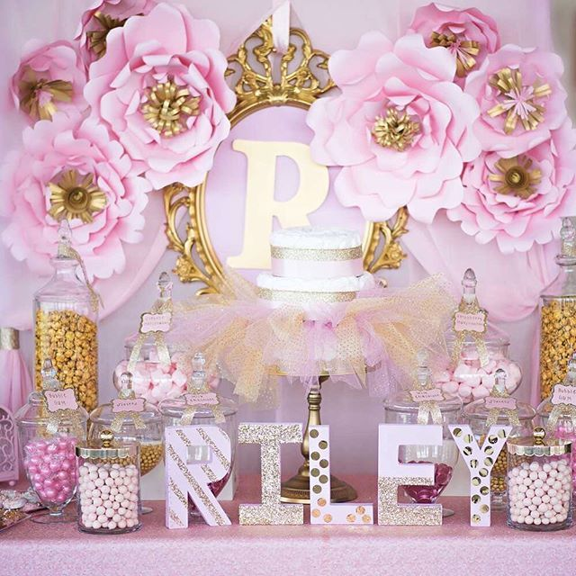Who wouldn't be blown away by this pink and gold princess baby shower from…