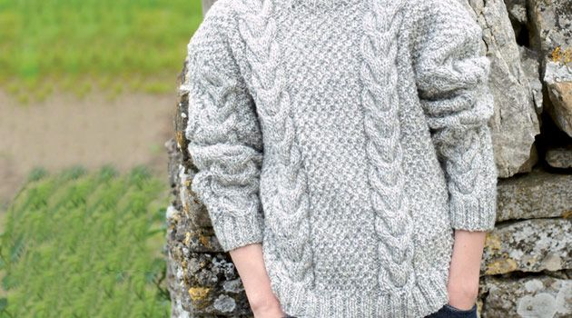 This Hayfield Aran jumper features traditional cable stitches and crew neck style. Children's and adults sizes are given in the pattern and an Aran vest op