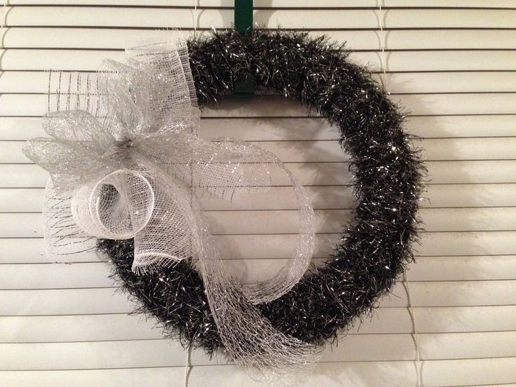 Sparkle yarn wrapped wreath with deco mesh bow.