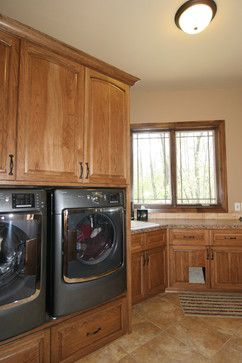 Southwestern style home - traditional - Laundry Room - Grand Rapids - Koetje Builders Inc - higher mounted washer and dryer - front loading