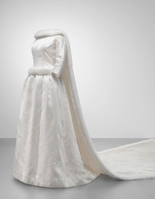 Wedding dress worn by Queen Fabiola of Belgium, December 1960  (worn in Brussels). The dress is made of satin and mink.  Via Mona Bismarck Foundation.