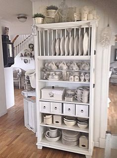 Take a bookcase, some wood boxes and an old plate rack and white paint and what have you got? Kitchen Storage! - via Shabby and Charme