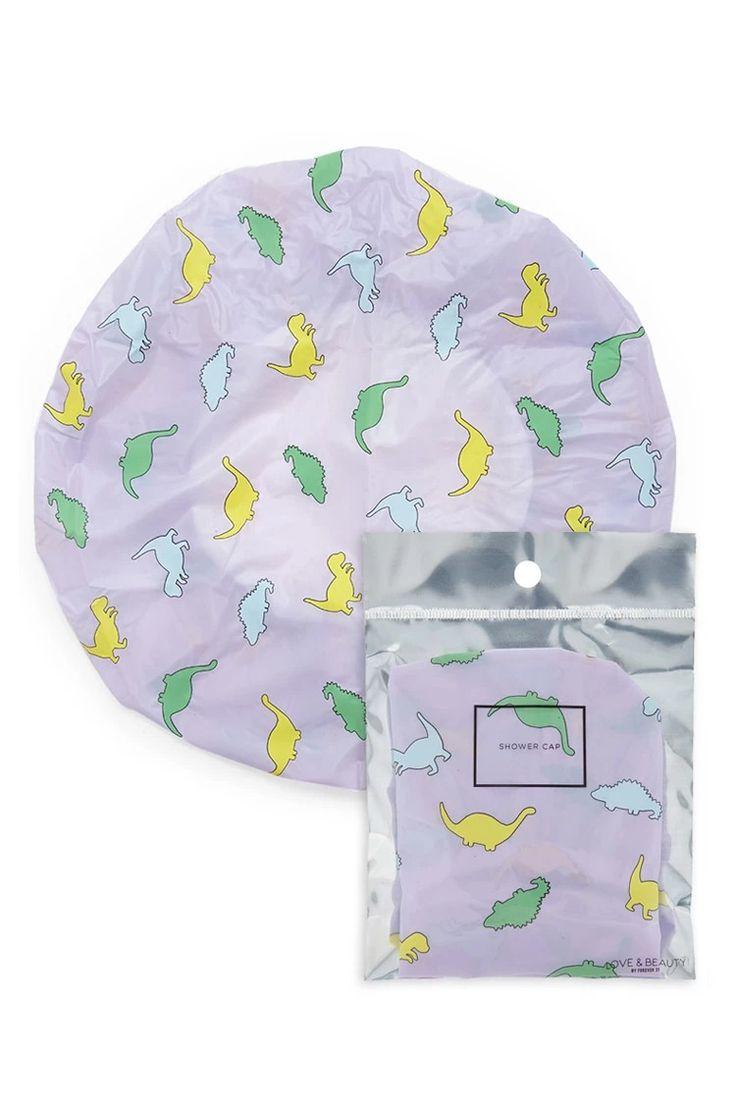A shower cap featuring an allover dinosaur print. #beautymark