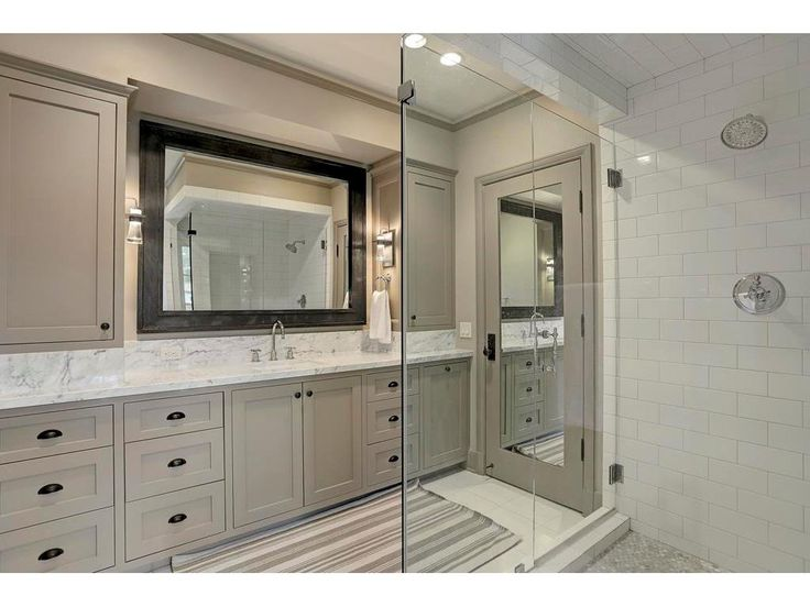 2 Greyton, Bunker Hill Village, TX: Photo The EN-SUITE BATH for the previous Secondary Bedroom has a large walk-in shower with a Subway tile surround, marble floor and frameless glass door entry.  The built-in cabinets have a Carrera marble top and tons of storage!