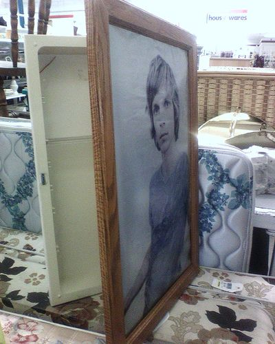 Hidden Storage: Old Medicine Cabinet is given new life when the mirror is replaced by a picture frame. Set in wall creates small hidden storage. Use for keys, jewelry and ?
