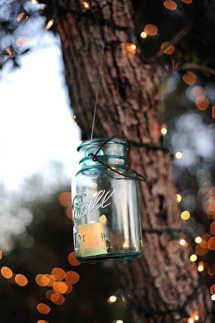 mason jar candle on tree