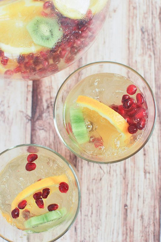 Sparkling Winter Sangria - orange, kiwi, and pomegranate all flavor this delicious sangria!