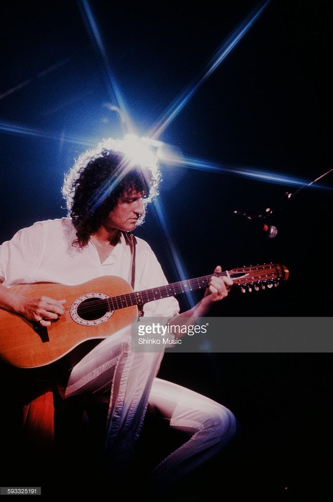 Queen Brian May live at Tokorozawa Seibu Lion's Baseball Stadium plays 12 string acoustic guitar, Saitama, November 3, 1982.