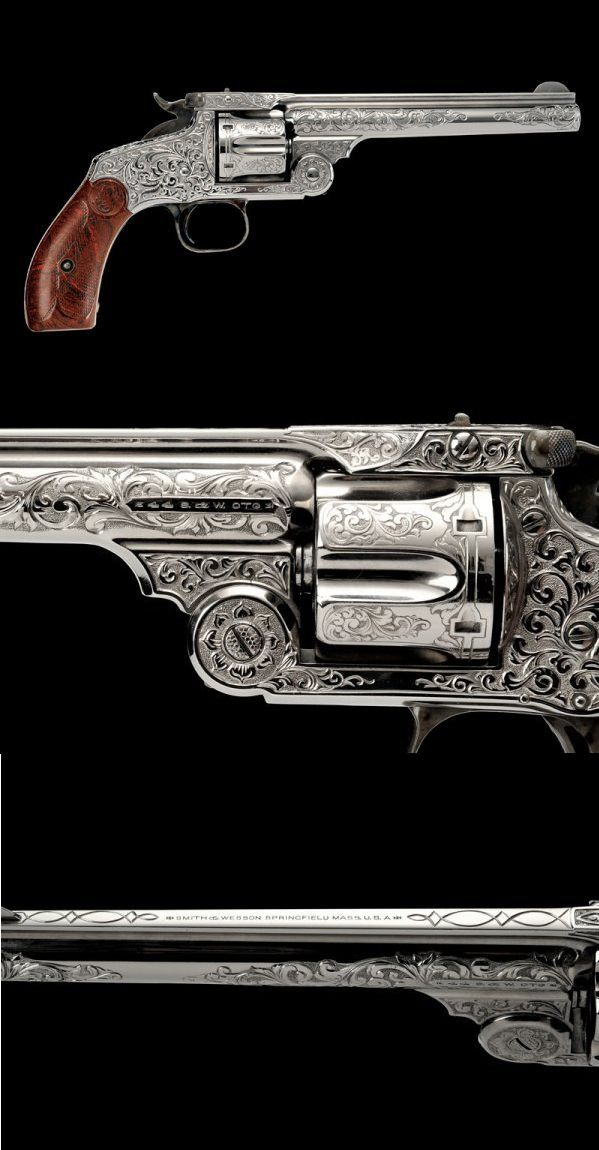 An interesting S&W New Mod No. 3 Single Action, late 19th century U.S.A. A beautiful piece absolutely mint, great photographs here !