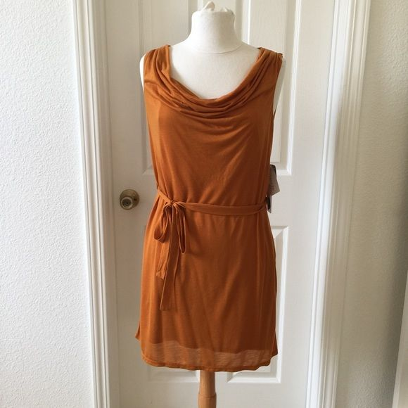 *SOLD* Forever 21 Mustard Colored Dress Forever 21 Mustard-colored dress. Never worn. Back has a cut-out on left side. It has another layer underneath to help make everything look seamless. Forever 21 Dresses