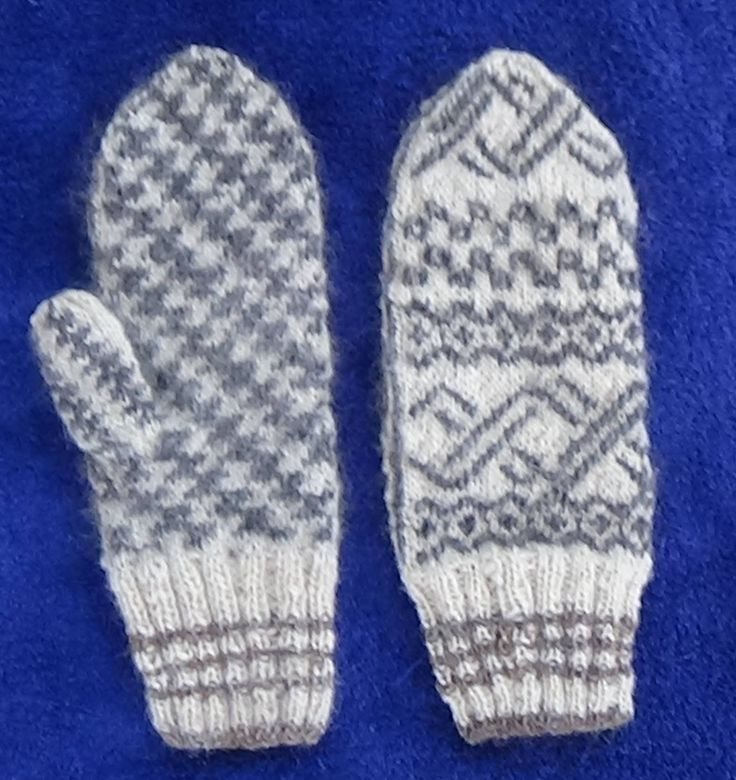 Drew the pattern for these mittens myself. I thought of the double helix of a DNA molecule, which I set in the middle and all the way up. The others are some sort of cells. On the thumb side is my design Navajo Lightning.  Hand spun wool and sheep's own colors.