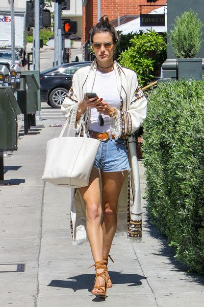 Alessandra Ambrosio goes out to enjoy the warm weather.