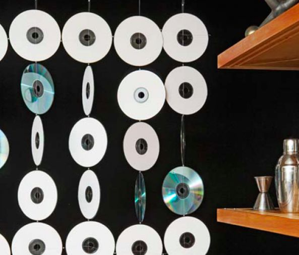 Spray paint old CDs in coordinating colors and attach together to make a hanging screen in a kid's room.