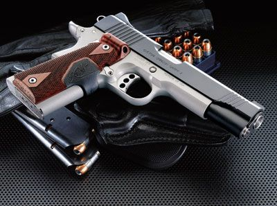 The Kimber 1911 is by far the most gorgeous gun you can get.  But the 4-figure price tag isn't for everyone.