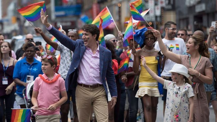 We can all agree Mr. Trudeau looked #stylish as heck in that his purple blazer pink dress shirt and casual chinos for a look that was #Pride & weekend ready- proving anytime is the right time to wear a blazer!