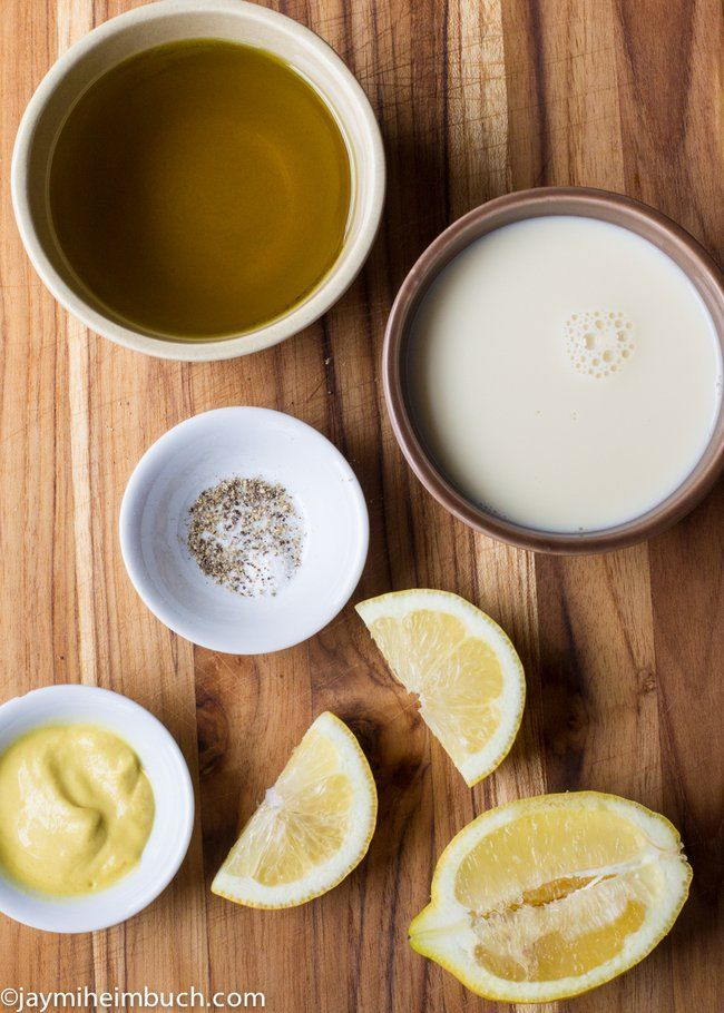 The ingredients for vegan mayonnaise with soy milk and olive oil
