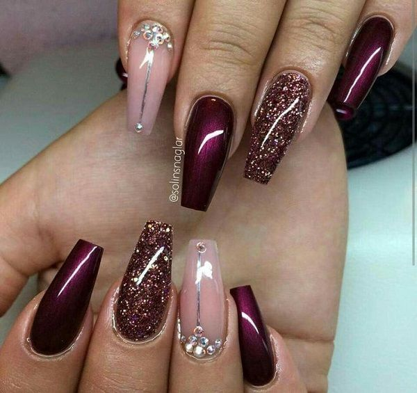 Glittery and shiny pink and maroon nail art design. The nails are absolutely…