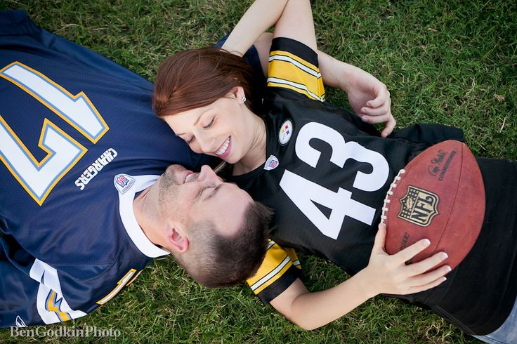 football inspired engagement photos- on the grass