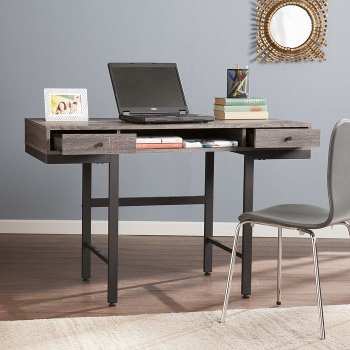 Go back in time to mid century fabulous with this writing desk in a workroom, home office, or living room. Wind-swept melamine veneer toughens up weathered gray, geometric and clean silhouette defines linear chic. Drawers conceal small office accessories and spacious shelf easily holds a laptop or tablet. Wide desktop and open sides hint at a desk built for sharing, but handsome contemporary details make you want to keep it all to yourself. Work smart, not hard, with this multitasking, mixed…