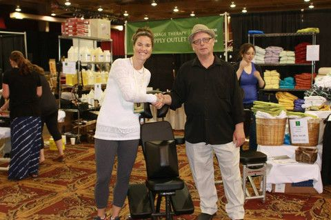 Is it your job, or your business? | Massage Therapy Supply Outlet - Joe Clare from MTSO congratulates a winner of the Massage Chair prize