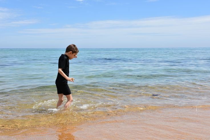 L1M1AP3:Rule of thirds,but also exploring taking pictures in direct sunlight,midday,my boy splashing in the water,iso 200,f/10,1/400sec.