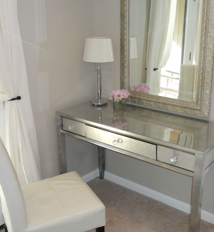 Little can match the glamour of a mirrored vanity table, but silver leaf can create a reflective glow in a pinch (and is a much easier DIY). See more at LiveLoveDIY »   - HouseBeautiful.com