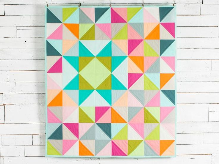 Stitch a dynamic blend of modern hues into your next quilt with this precut-friendly top. Brightly colored solid half square triangle quilt kit. Disclosure: This is an affiliate link and if you click the link and make a purchase I will receive a commission. This does not increase the cost to you.