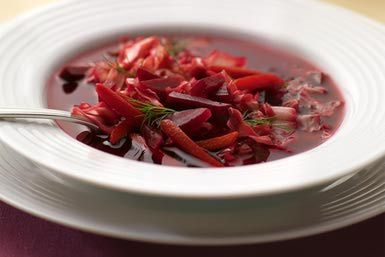 Beet and Cabbage borscht in bowl - Sharon White / Photographer's Choice / Getty Images