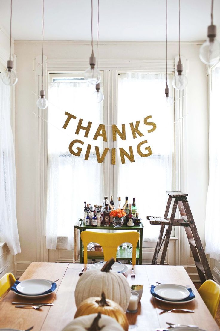 Add a sparkly garland as a celebratory backdrop to your Thanksgiving table with this fall DIY banner craft by A Beautiful Mess.