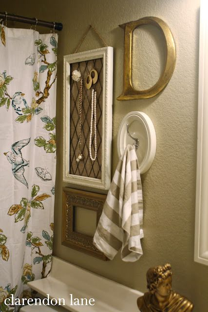 Bathroom decor. Love the towel hook inside a frame.