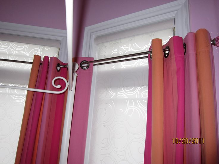 Draperies and roller shades in a little girl's room!