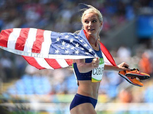 Emma Coburn celebrates the bronze medal in the women's