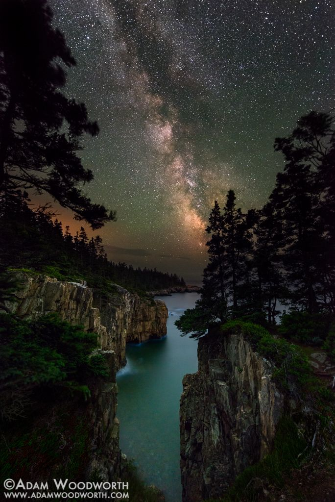 Photographer Adam Woodworth captured this jaw-dropping view of the Milky Way over Raven's Nest cliff in Maine's Acadia National Park.
