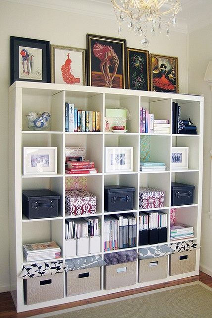 This picture makes me want to go to Ikea, buy an Expedit bookshelf, (pay someone to put it together,) and start organizing the hell out of my house.