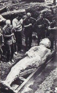 """The fossilized Irish giant from 1895 is over 12 feet tall. The giant was discovered during a mining operation in Antrim, Ireland. This picture is courtesy """"the British Strand magazine of December 1895"""" - Height, 12 foot 2 inches; girth of chest, 6 foot 6 inches; length of arms 4 foot 6 inches. There are six toes on the right foot."""