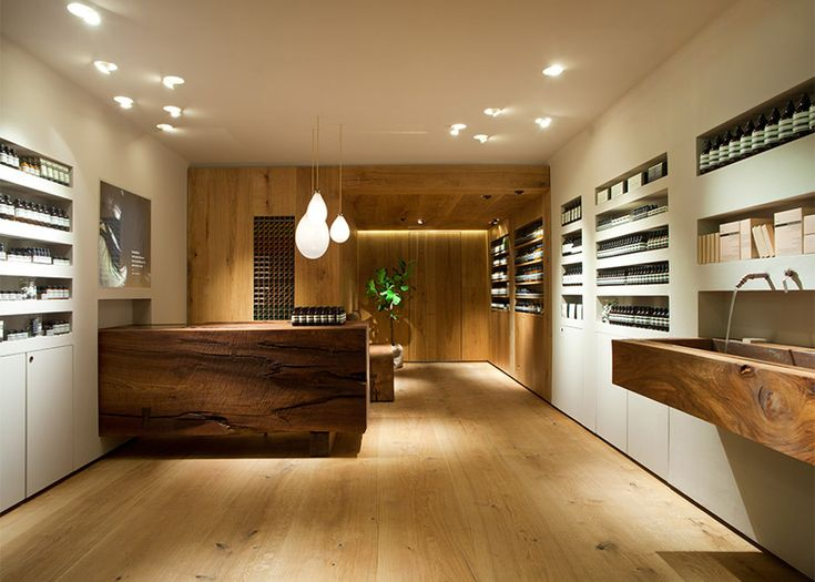In Praise of Shadows' Aesop store uses dead wood from a Stockholm park