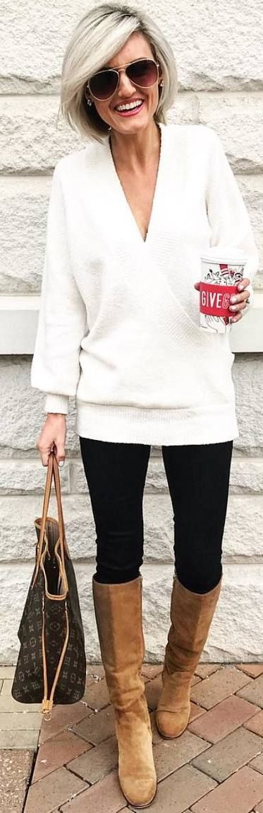 #winter #outfits white loose sweater, black pants, brown boots, bag
