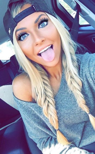 Double fishtail braids with bleached blonde hair color