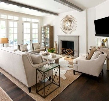 Cowhides Layered Over Natural Fiber Rugs. Living Room ...