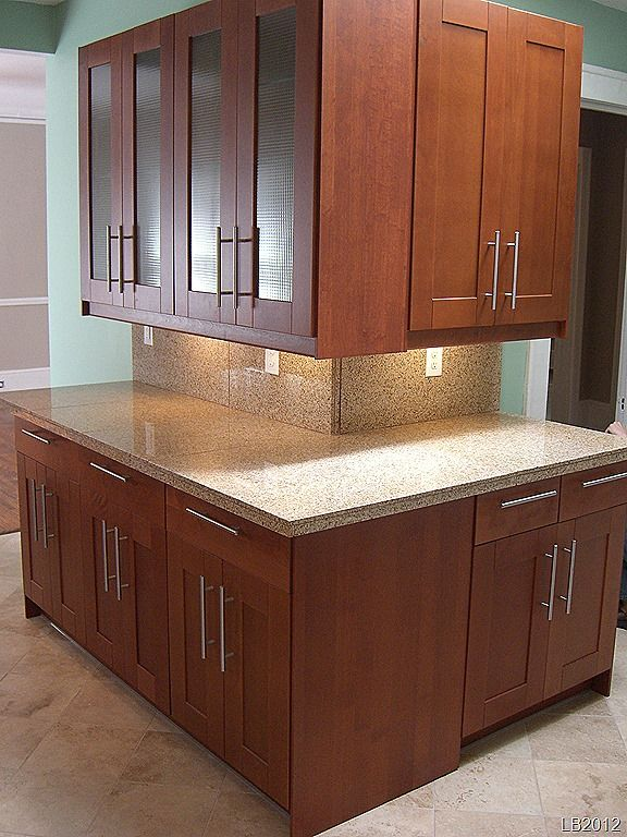 A Nice Corner In A Rental Unit With Adel Medium Brown Cabinets And Under Cabinet Lighting
