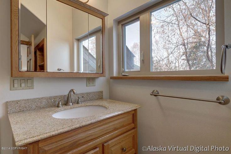 Craftsman Powder Room with specialty door, Simple Granite, Undermount sink, Raised panel, Powder room, High ceiling