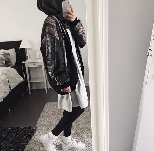 Black pants, white shirt, printed jacket, black scarf, white socks, white shoes