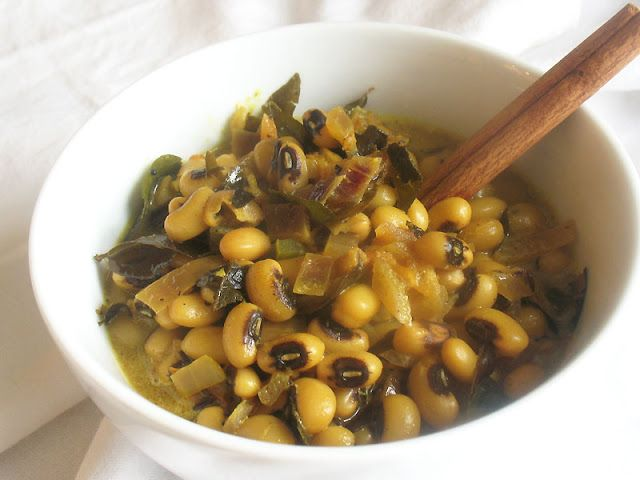 Black-Eyed Peas with Coconut Milk, Curry Leaves and Spices. A simple and delicious black-eyed pea curry simmered in a warm coconut milk and tomato gravy with smoky spices served up with steamed collard greens for good luck on New Years Day.