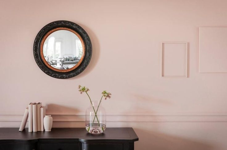 A convex glass mirror that gives amazing space and character